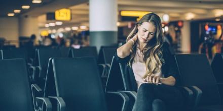 Image: Woman at airport waiting area