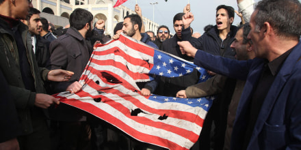Image: Iranians tear up a U.S. flag during a demonstration in Tehran on Jan. 3, 2020 following the killing of Iranian Revolutionary Guards Major General Qassem Soleimani in a U.S. strike on his convoy at Baghdad international airport.