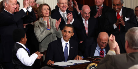 Image: President Barack Obama is applauded after signing the Affordable Care Act in the East Room of the White House on March 23, 2010.