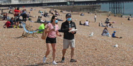Masks have become a common sight on beaches as attractions reopen during the coronavirus pandemic.