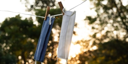 Washable protective fabric face masks on the wash line outdoors