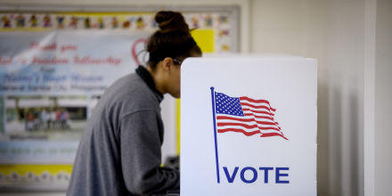 Image: A voter casts a ballot during midterm elections in Cambridge, Ohio