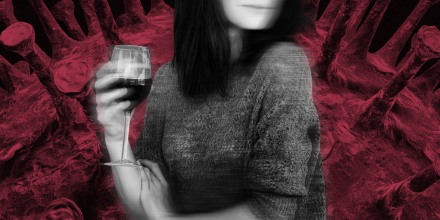Image: A woman, semi-blurry, drinking red wine as a giant coronavirus spore looms in the background.