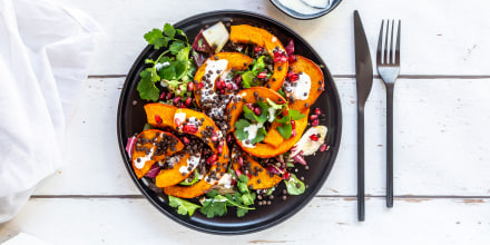 Autumnal salad with fried pumpkin, lentils, radicchio, pomegranate seeds, leaf salad and parsley with dressing
