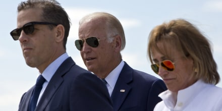 Image: U.S. Vice President Joe Biden, centre, his son Hunter Biden, left, and his sister Valerie Biden Owens, right, joined by other family members during a ceremony to name a national road after his late son in the village of Sojevo, Kosovo.