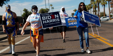 Image: People promote the importance of the Latino vote in Maryvale, Phoenix