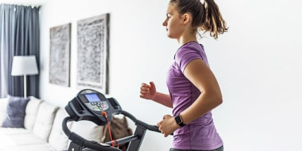 Woman running on her home treadmill