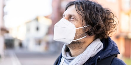 MIddle age man wearing in EU obligatory FFP2/KN95/N95/ protective mask