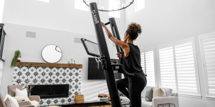 Woman working out on vertical climber. These are the 6 best vertical climbers, according to fitness experts and personal trainers. Use this guide to find the best vertical climber for your home gym.