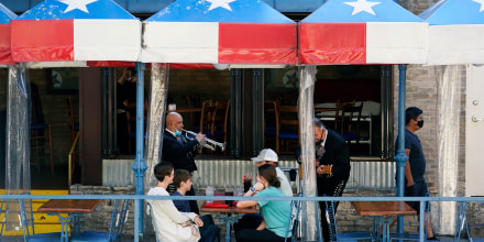 Image: Mariachi perform for diners at a restaurant on the River Walk in San Antonio