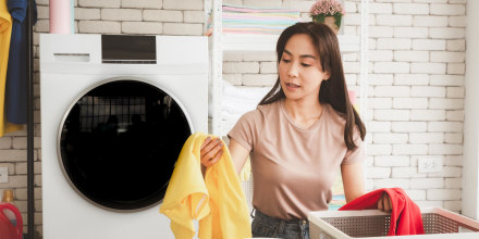 Woman organizing her laundry in her laundry room