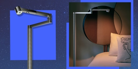 Illustration of a starry night background and a Dyson Lightmorph Cycle lamp in a bedroom and a black Dyson Lightmorph Cycle lamp