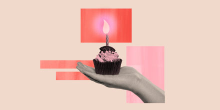 Image: Illustration of hand holding a cupcake with birthday candle