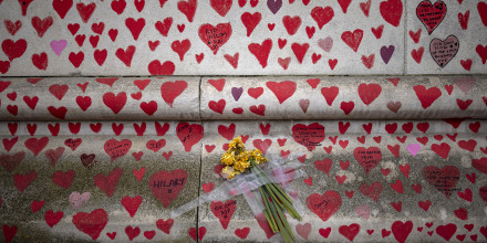 Image: Daffodils are taped to the National Covid Memorial Wall on April 21, 2021 in London.