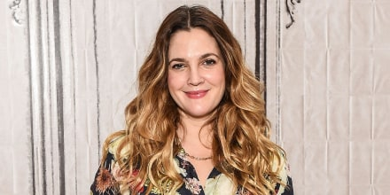 Image of Actress Drew Barrymore wearing a floral dress