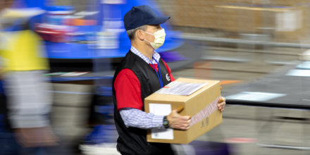 A contractor working for Cyber Ninjas transports ballots from the 2020 general election during an audit on May 1, 2021, in Phoenix.