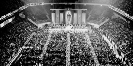 """Nazi storm troopers fill the aisles as the crowd sings \""""The Star Spangled Banner\"""" at the opening of the German-American Bund's \""""Americanization Rally\"""" at Madison Square Garden on Feb. 20, 1939."""