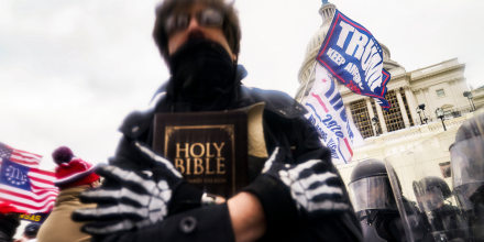 A man holds a Bible as Trump supporters gather outside the Capitol in Washington on Jan. 6, 2021.