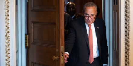 Senate Majority Leader Chuck Schumer, D-N.Y., exits a lunch with Senate Democrats at the Capitol on June 22, 2021.