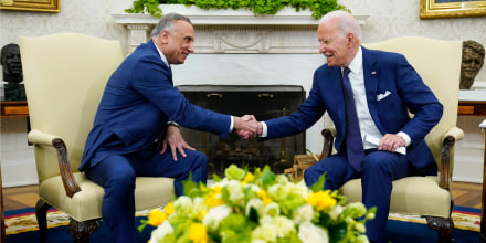 President Joe Biden shakes hands with Iraqi Prime Minister Mustafa al-Kadhimi during their meeting in the Oval Office on July 26, 2021.