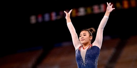 Image: Sunisa Lee of the United States competes in the balance beam event of the artistic gymnastics women's all-around final during the Tokyo Olympic Games at the Ariake Gymnastics Centre on July 29, 2021.