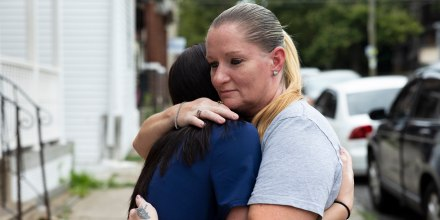 Miltreda Kress hugs her daughter, Brianna Donahue, in front of their home in Philadelphia.