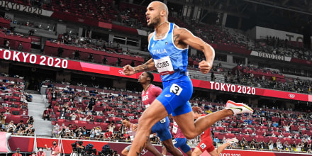 Italy's Lamont Marcell Jacobs celebrates as he crosses the finish line to win the men's 100m final during the Tokyo Games on Aug. 1, 2021.