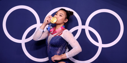 Image: Sunisa Lee kisses her gold medal at the Tokyo Olympics on July 29, 2021.