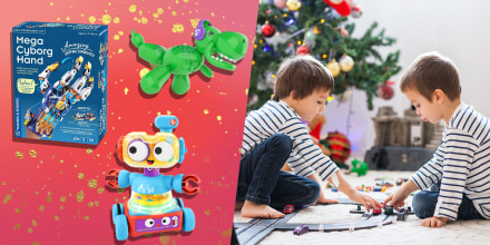 Two adorable boys, playing with toys on Christmas and three different types of toys