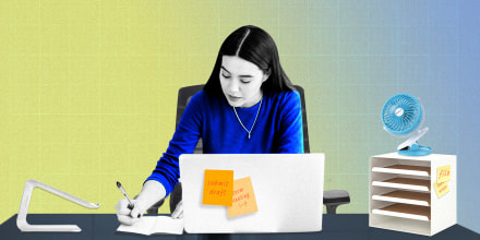 Illustration of a Woman sitting at her desk in a Branch Ergonomic Chair, writing in her notebook, surrounded by the IKEA KVISSLE Letter Tray and SkyGenius Clip-On Mini Desk Fan