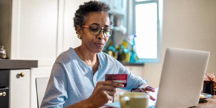 Senior woman online shopping on her laptop