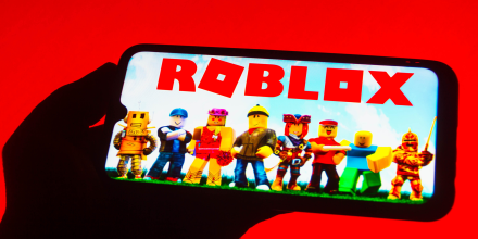 In this photo illustration the Roblox logo seen displayed on