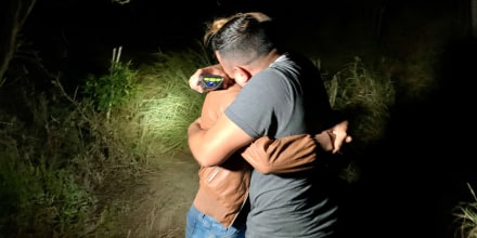 Honduran immigrant Edín Galeano hugs his partner after finding her on the bank of the Rio Grande, Texas, after more than five years without seeing her.