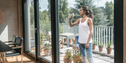 Woman cleaning balcony window