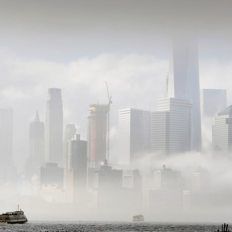 Image: A commuter ferry crosses the Hudson River to New York City
