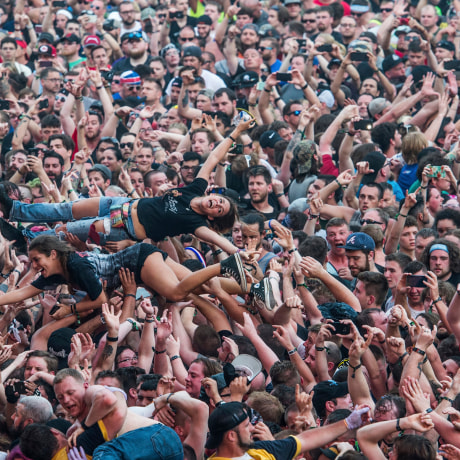 Image: Fans crowd surf at the Rock On The Range music festival in Columbus, Ohio