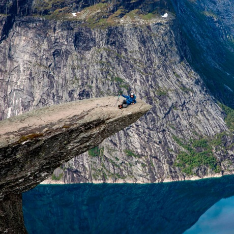 """Image: Tourists visit the """"Trolltunga"""" rock in Norway"""