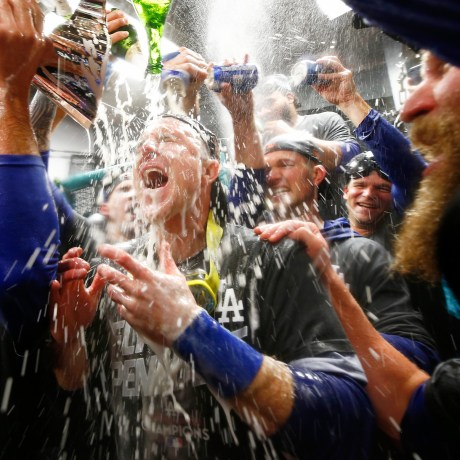 Image: Chase Utley #26 of the Los Angeles Dodgers celebrates in the clubhouse