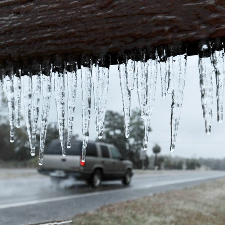 Image: Icicles hang from a sign in Hilliard, Florida