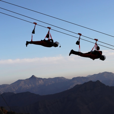 Image: People ride world's longest zip-line over Ras al-Khamiah's Jabal Jais Mountain