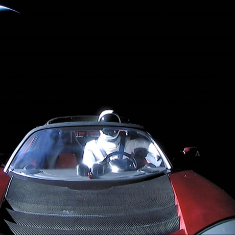 """""""Starman,"""" a dummy driver, sits at the steering wheel of a #Tesla Roadster as it travels through #space leaving #Earth in the distance. The world's first space car was the unorthodox cargo aboard #SpaceX's new Falcon Heavy rocket during a test flight on Tuesday."""