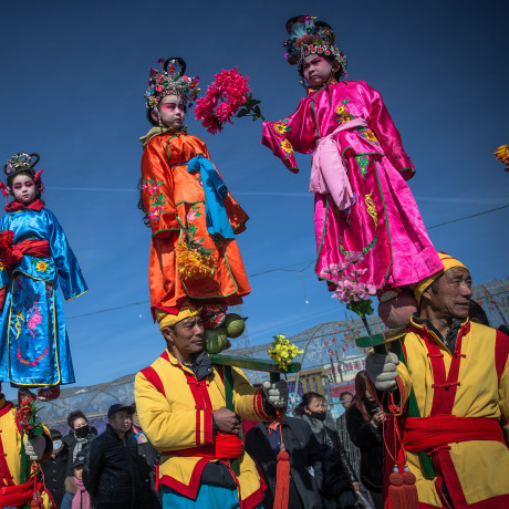 Image: Chinese folk artists perform during a parade celebrating the upcoming Lantern Festival