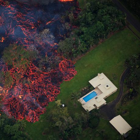 Image: Lava flows into the Leilani Estates subdivision after a fissure eruption