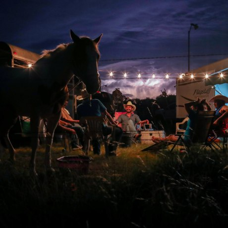 Image: Lightning fills the sky as cowboys from the Rio Grande Valley set up camp after arriving for Memorial Day weekend