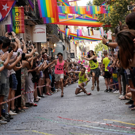 Image: Contestants take part in the annual race on high heels during gay pride celebrations in the quarter of Chueca in Madrid