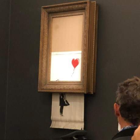 The canvas work depicting a girl reaching toward a red heart-shaped balloon is one of Banksy's best-known pieces.