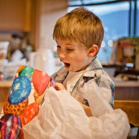 Boy opening birthday gift