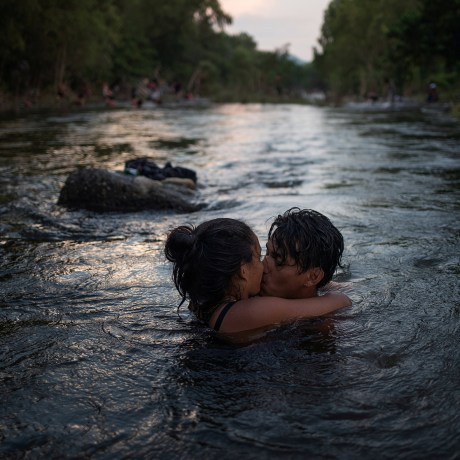 Image: Couple kiss in Rio Novillero as caravan from Central America en route to U.S. stops in San Pedro Tapanatepec, Mexico