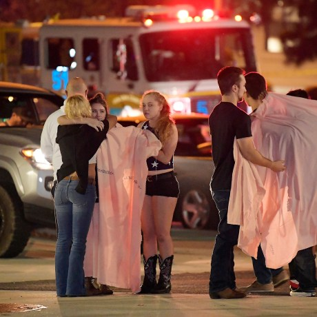 People comfort each other near the scene of Wednesday's mass shooting in Thousand Oaks, California.