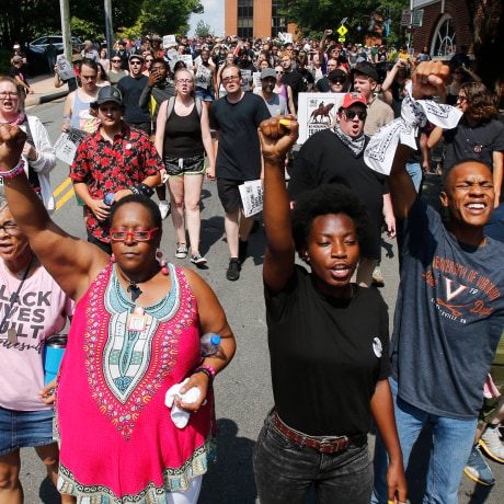 Image: Demonstrators against racism march along city streets as they mark the anniversary of last year's Unite the Right rally in Charlottesville